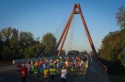 Runners cross Robert N. Stewart bridge in downtown Columbus during the annual Mill Race Marathon