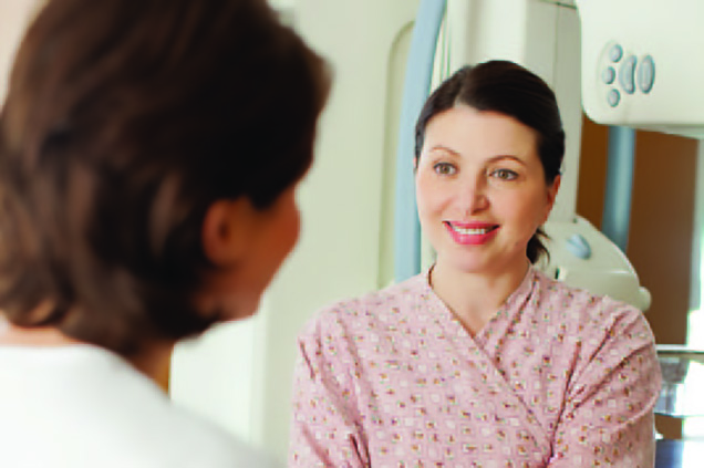 Physician speaking to female patient