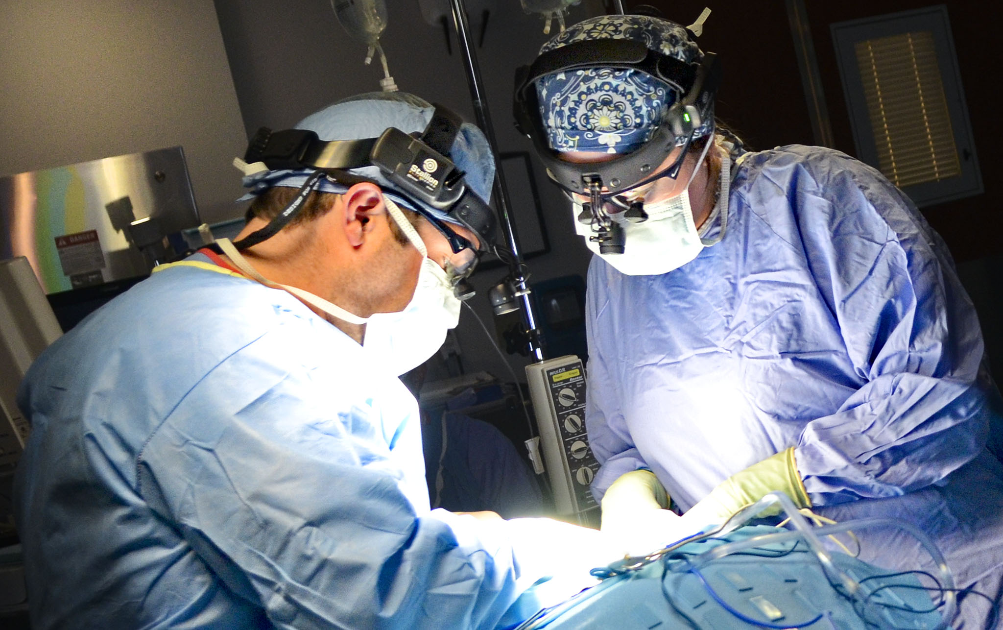 Drs. Mark and Allison Royer during a recent surgical procedure