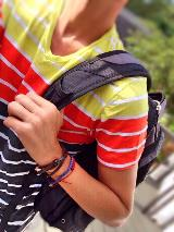 Boy with backpack over his shoulder