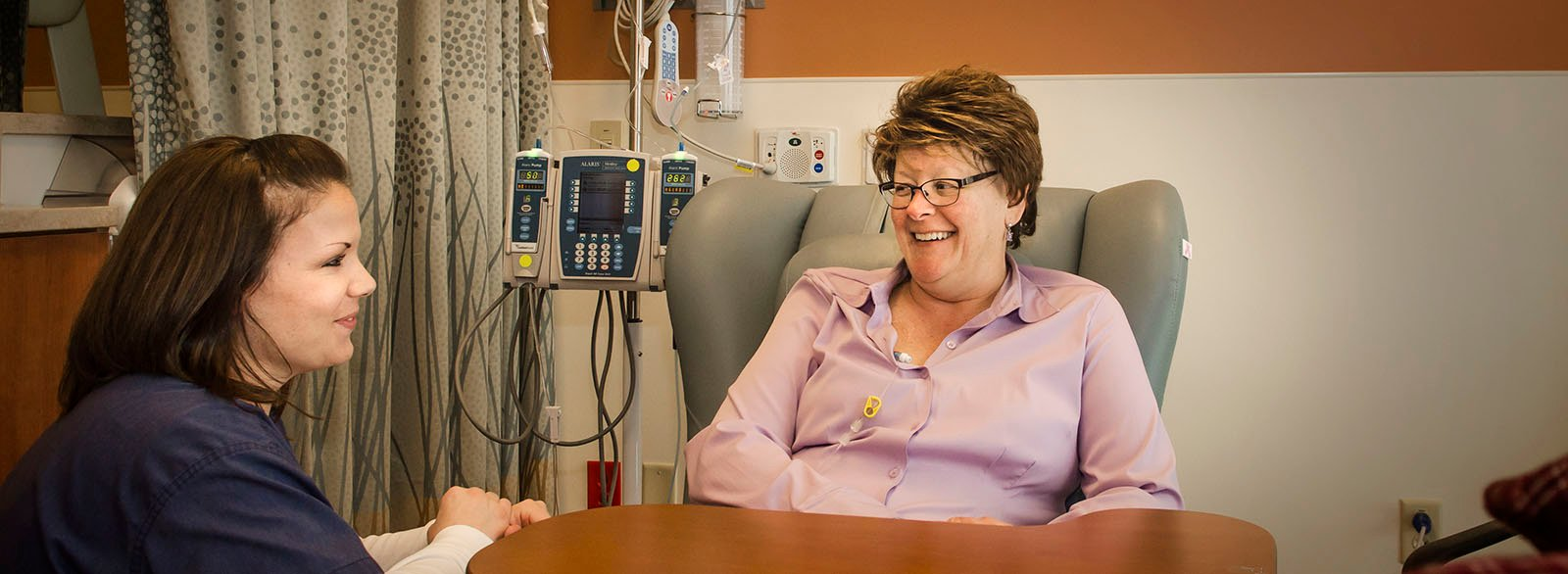 Cancer Center nurse with chemotherapy patient