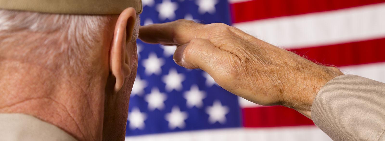 Veteran saluting the American Flag