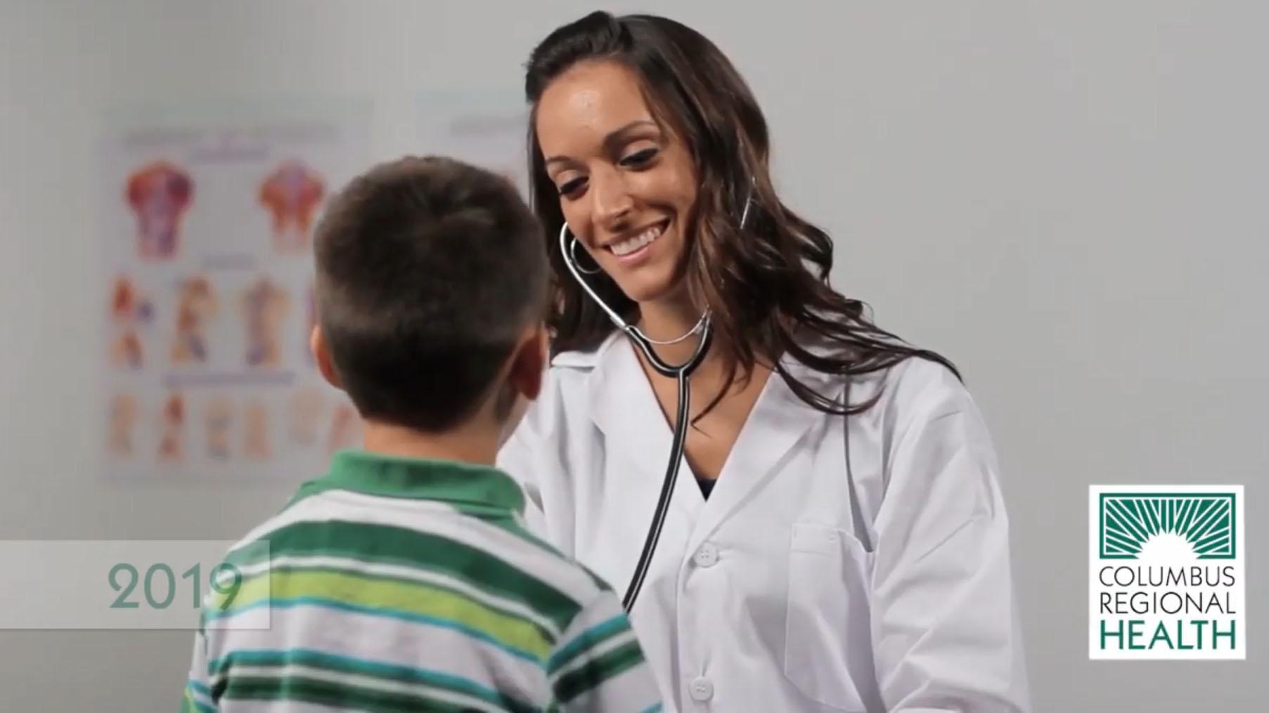 Nurse examining pediatric patient.