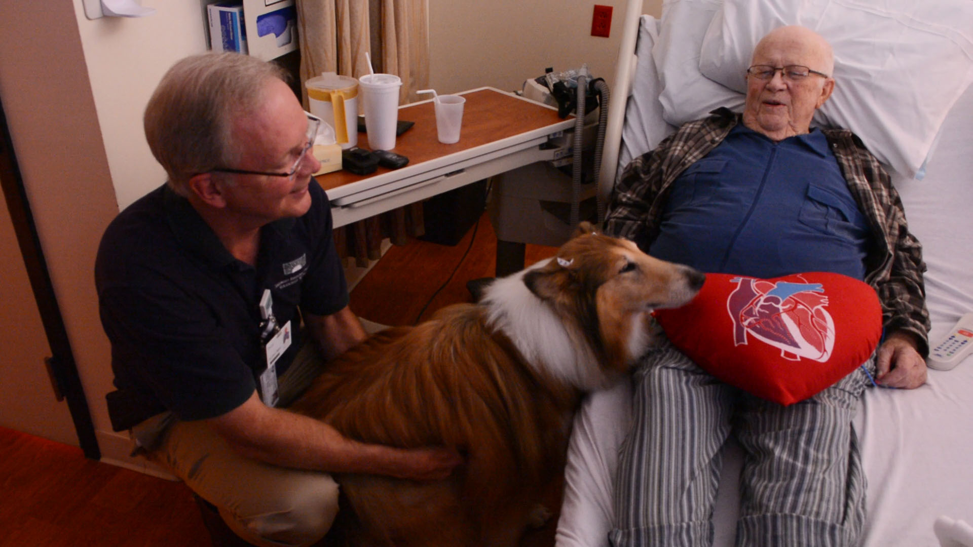 Doug Bell and therapy dog Bonnie visit a patient at Columbus Regional Hospital