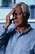 Picture of an older man clenching his aching head