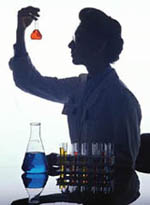 Picture of a female pathologist examining a container of liquid