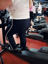 Photo of overweight person on an elliptical trainer
