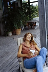Woman relaxing on her patio