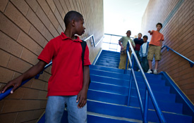 Boy being threatened or teased on the stairs at school