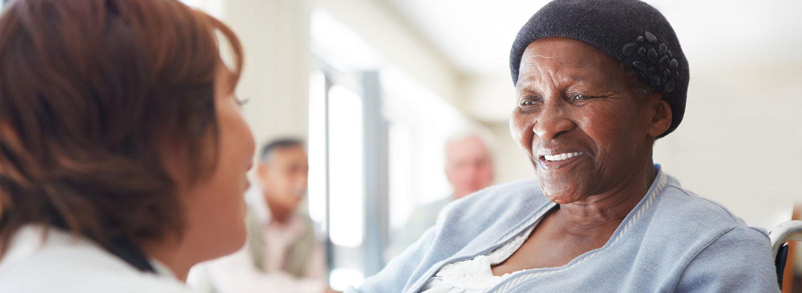 Provider speaking with elderly female patient