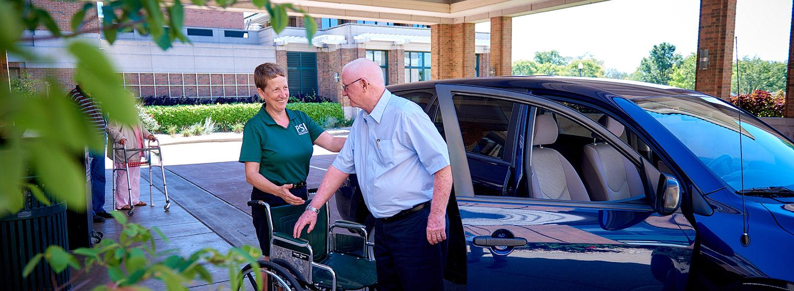 Valet service assisting visitor