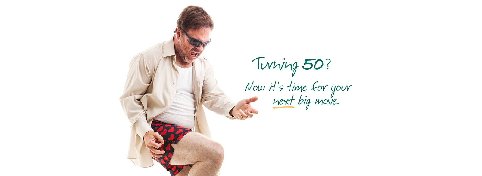 Middle-aged man in boxer shorts playing air guitar