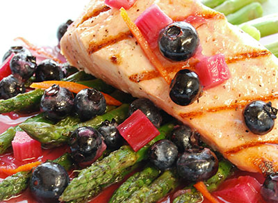 Seared salmon topped with blueberries
