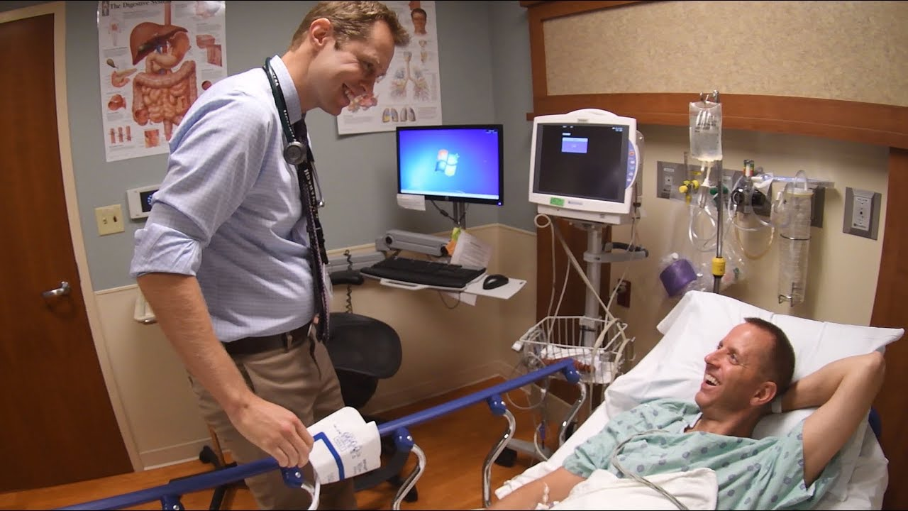 Gastroenterologist Patrick Barrett, MD, talks to patient Brad Davis before performing his colonoscopy.