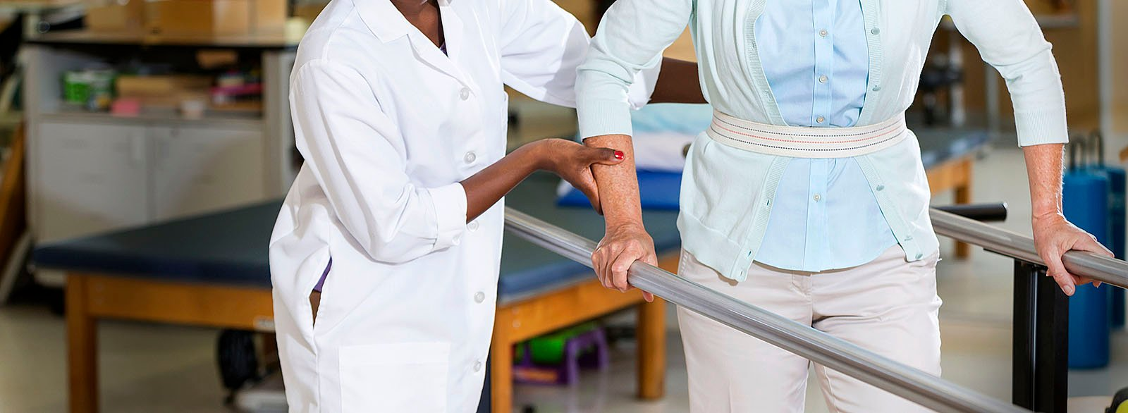 Occupational therapist working with patient